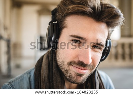 young handsome fashion model using tablet man outdoors - stock photo