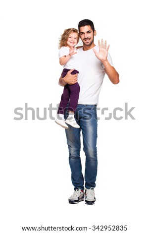 young handsome father holding his daughter in his arms and smiling, isolated on white - stock photo