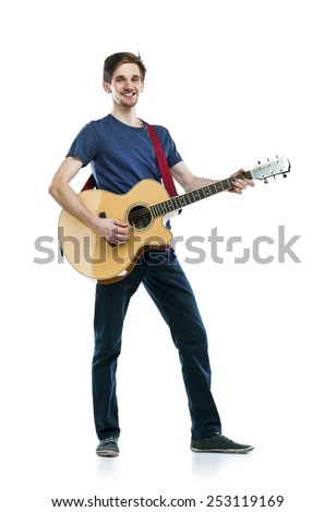 Young handsome guitar player with his instrument. Studio shot on white background. - stock photo