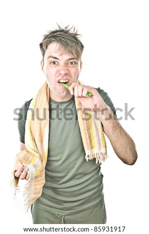 young handsome guy brushing his teeth, isolated over white - stock photo