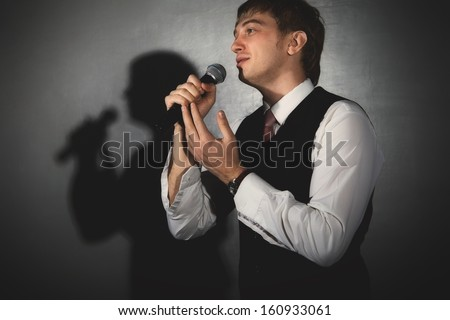 Young handsome guy singing. Jazz musician - stock photo