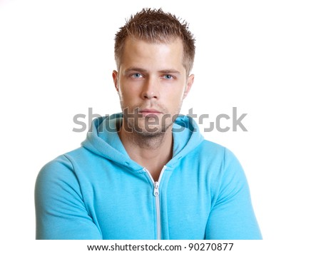 Young handsome guy wearing a hoodie, on white