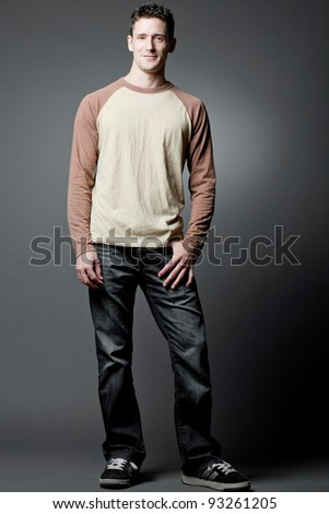 Young handsome happy man wearing casual cloths. - stock photo