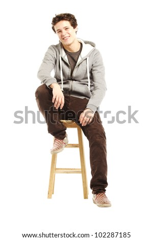 Young handsome happy man with hip style looking at camera - stock photo