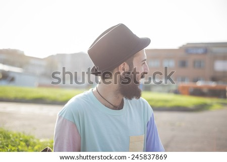 young handsome hipster gay modern man in town - stock photo