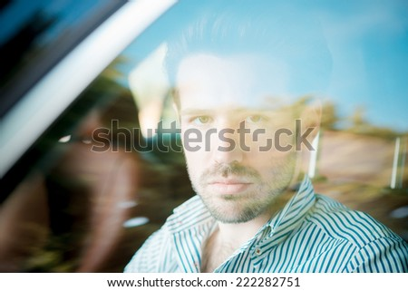 young handsome hipster modern man outdoor driving car in summertime - stock photo