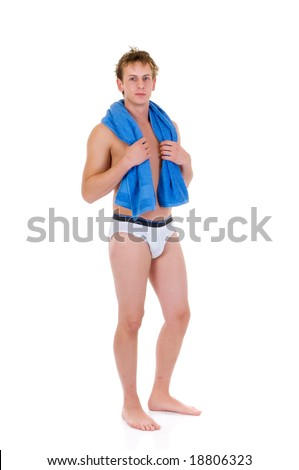 Young handsome lingerie model, man in briefs, towel around neck,  Studio shot, white background - stock photo