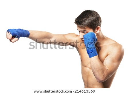Young handsome male boxer making punches during training isolated on white background - stock photo