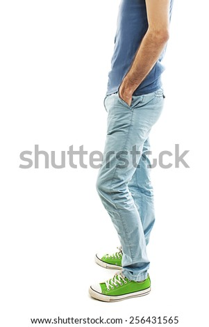 Young handsome male in pants with hands in pockets. Isolated on white background  - stock photo