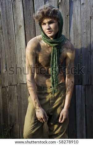 Young handsome male model posing outdoors - stock photo