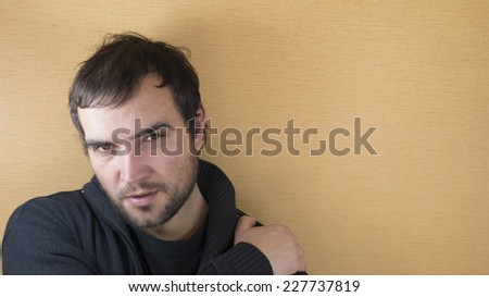 Young handsome man against yellow background with lots of copy space - stock photo