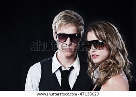 Young handsome man and young pretty woman in sunglasses - stock photo