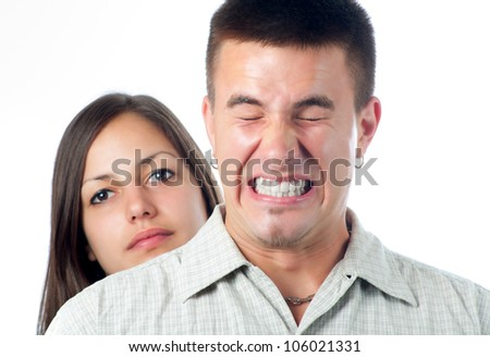 Young handsome man annoyed buy his girlfriend isolated on white.