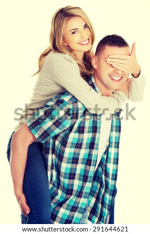 Young handsome man carrying his beautiful woman - stock photo
