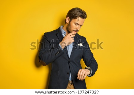 Young handsome man checking the time - stock photo