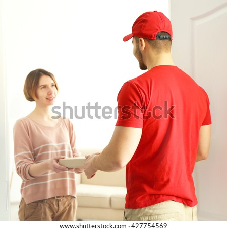 Young handsome man delivering pizza - stock photo