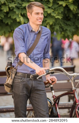 Young handsome man dressed casual riding bicycle. Healthy lifestyle concept.