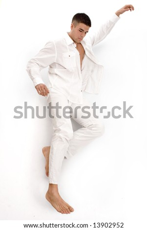 young handsome man dressed in white summer clothes on white