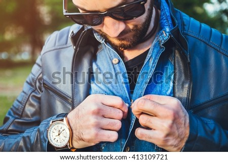 Young handsome man dressing up and buckle shirt - stock photo
