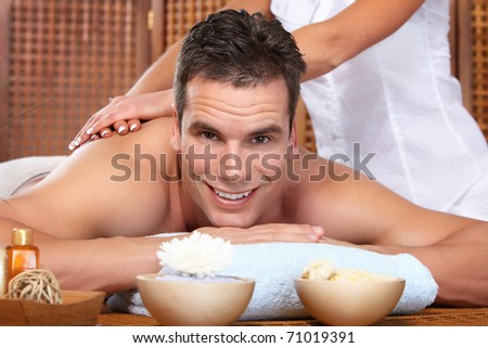 young handsome man getting a massage - stock photo