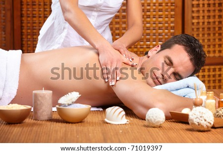 young handsome man getting a massage