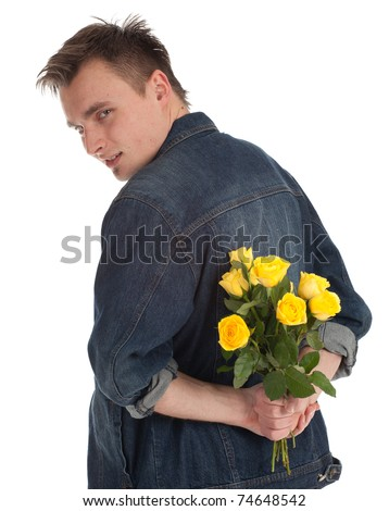 young handsome man holding a yellow roses - stock photo