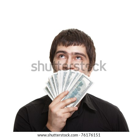 Young handsome man holding dollars - stock photo