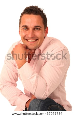 Young handsome man in a pink shirt with a happy smile