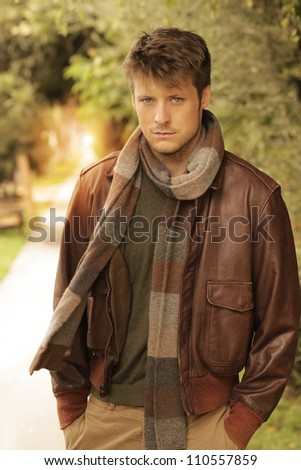 Young handsome man in autumn  outdoor setting wearing fashionable clothing - stock photo