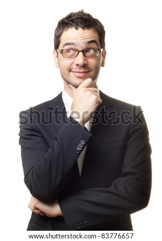Young handsome man in black suit and glasses looking at copy-space thinking or dreaming