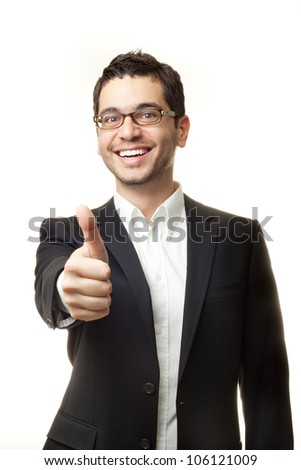 Young handsome man in black suit and glasses smiling and showing thumbs up isolated on white background - stock photo