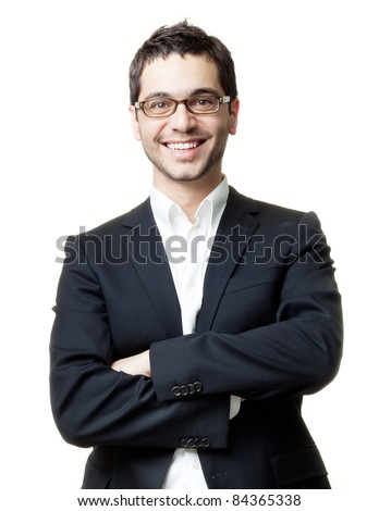 Young handsome man in black suit and glasses smiling isolated on white background