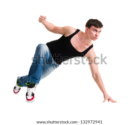 young handsome man in blue jeans showing some movements against isolated white background - stock photo