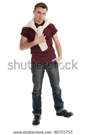 young handsome man in brown casual shirt and sweater on shoulders - stock photo
