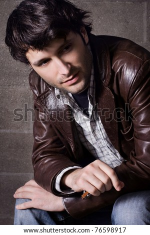 Young handsome man in casual style clothing - stock photo