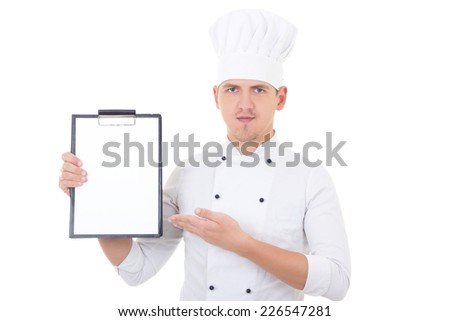 young handsome man in chef uniform showing clipboard with copy space isolated on white background - stock photo