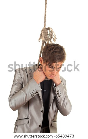 young handsome man in grey suit and gallows - stock photo