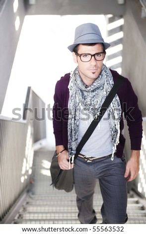 Young handsome man in human background - stock photo