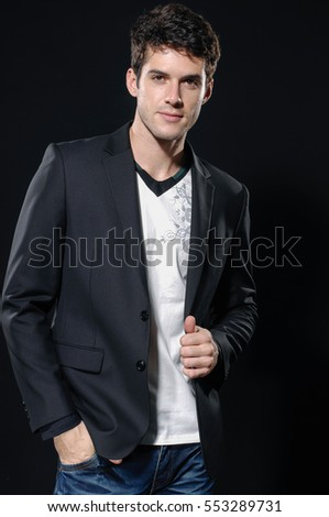 young handsome man in jeans Studio fashion portrait.-black background