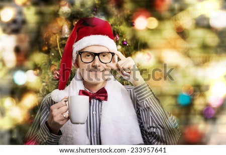 young handsome man in Santa caps - stock photo
