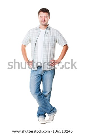 young handsome man in shirt and jeans posing over white background - stock photo