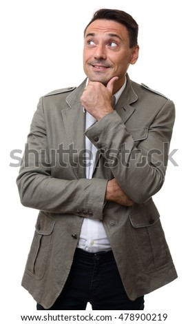 Young handsome man in trendy jacket thinking or dreaming and looking at copy space