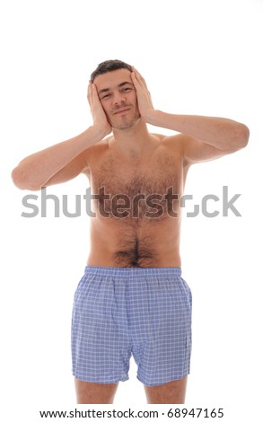 Young handsome man in underware waking up in the morning and yawning. isolated on white background - stock photo