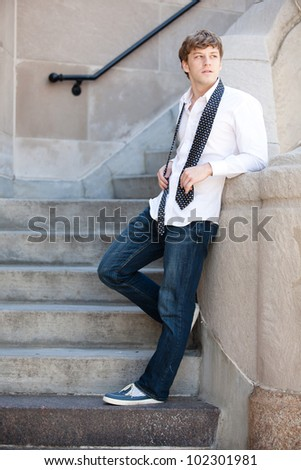Young handsome man in while shirt relaxing. - stock photo