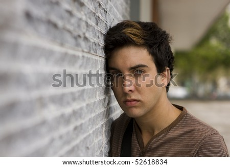 Young handsome man looking to you - stock photo