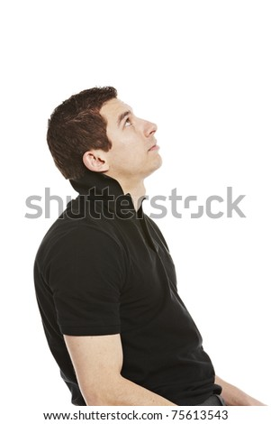 Young handsome man looking up at copyspace, your product. Isolated on white background - stock photo