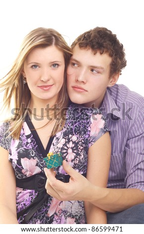 young handsome man making a ring to his girlfriend - stock photo