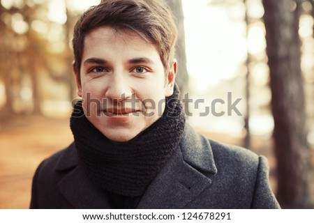 Young handsome man outdoor closeup portrait. - stock photo