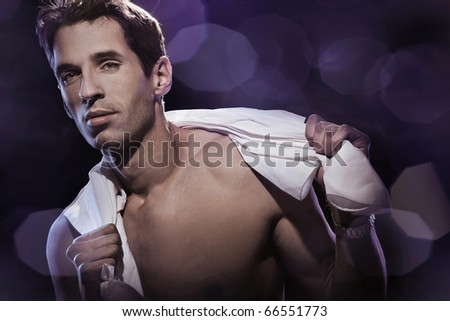 Young handsome man over dreamy violet background
