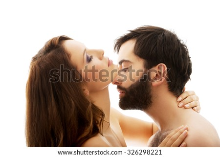 Young handsome man pretending to kiss woman's neck.